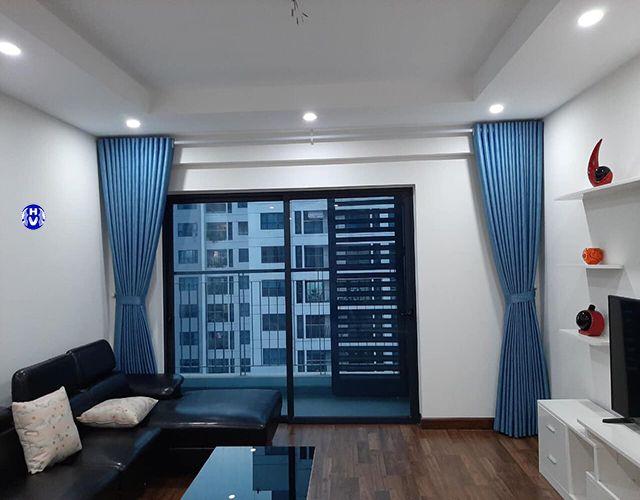 Mẫu rèm vải màu xanh dương nhạt phòng khách