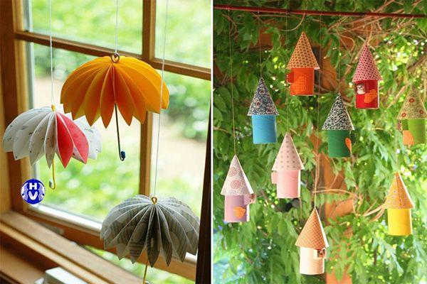 Từng chiếc ô gấp giấy nối với nhau bằng chỉ màu trang trí cửa sổ lạ mắt hơn